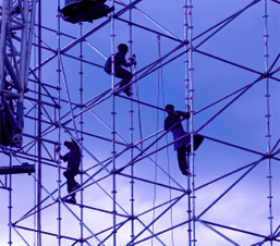 Silhouette of workers on scaffolding
